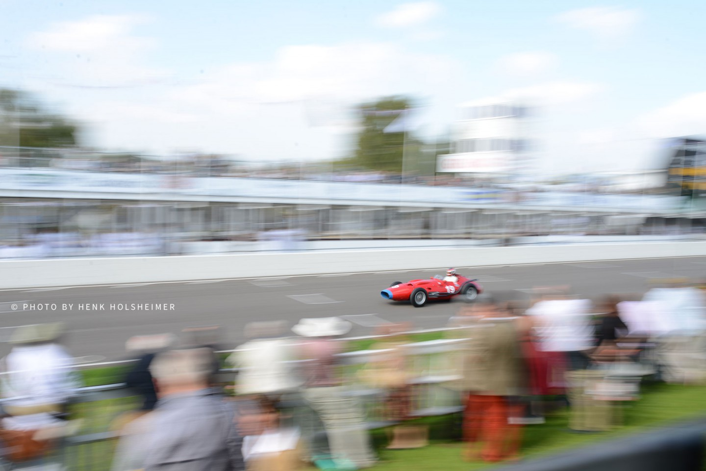 A Maserati 250F seen from the Startline Grandstand at the Goodwood Revival 2014
